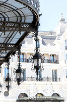 Lamps outside the entrance to the Monte Carlo Casino with the entrance to Hôtel de Paris Monte-Carlo in the background | Cattie Coyle Photography